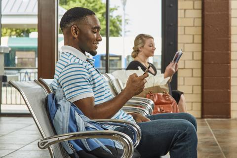 Man and woman sitting at Downtown Denton Transit Center