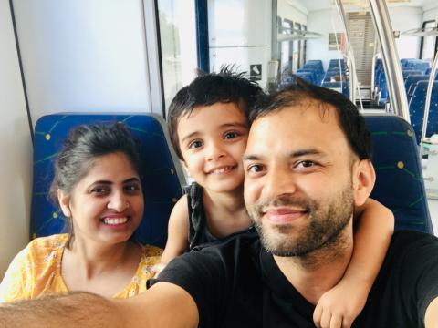 Hitesh and Family posing on train