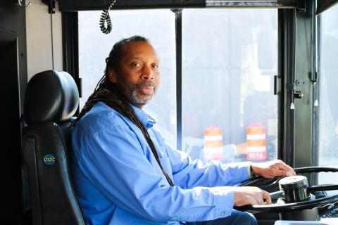 Bus driver sitting on a bus
