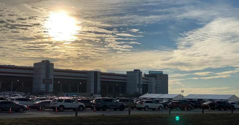 Image of cars lined up to receive vaccinations. Photo from Texas Motor Speedway Website